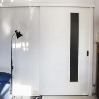 Drzwi przesuwne Porta kolor lakier standard biały. Lokalizacja ul Limanowskiego